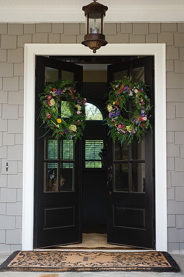 "This inspirational entry offers the simplicity of black doors with lots of window panes and an overhead lamp (get the look with Acclaim Lighting from Walton Collection) to guide the way from guest blogger/photographer Laurie Flickinger on ""Click It Up A Notch."""