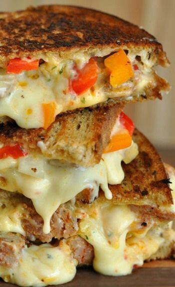 Sausage and pepper grilled cheese. Use mozzarella of course. and garlic bread doesn't hurt either. Just an awesome grilled cheese.