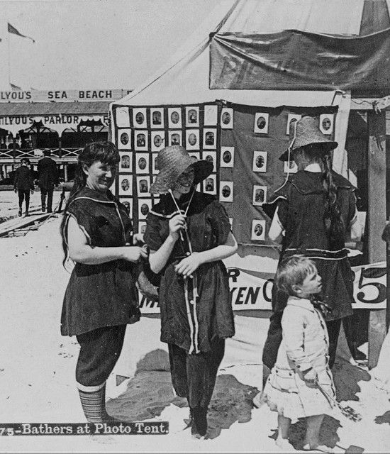 """America's Gilded Age era, c.1897. """"Bathers at Photo Tent"""". ladies in wool bathing suits and straw hats. - Coney Island beach, NY. ~ {cwl} ~ (Original Image: LOC)"""