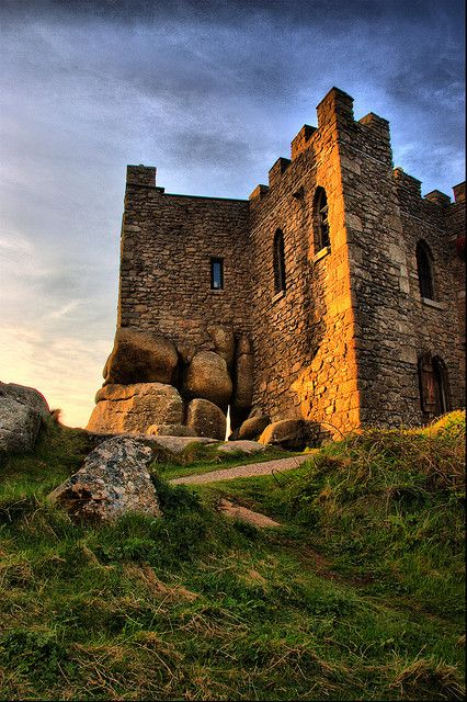 "Carn Brea Castle: ""Just to the south of Camborne and Redruth, the humpback ridge of Carn Brea is one of the great landmarks of west Cornwall, crowned as it is with what looks from a distance like a giant chess piece, and a little lower down embellished with a fortress-like building."" www.bradtguides.com"