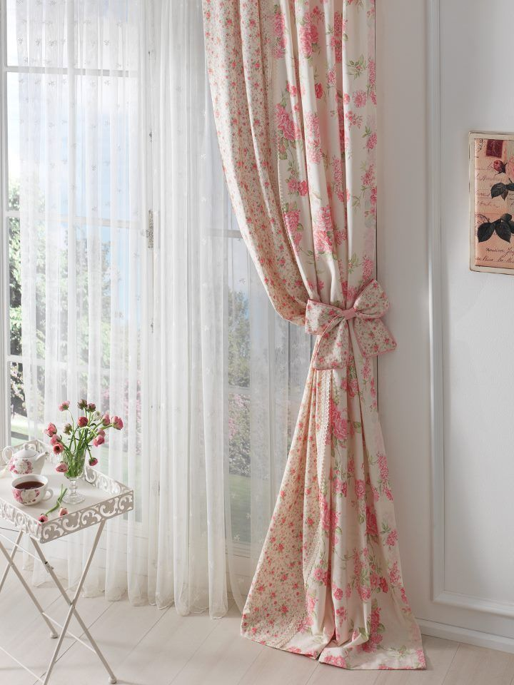 Pink flowered curtains as such but without the bow tie-back
