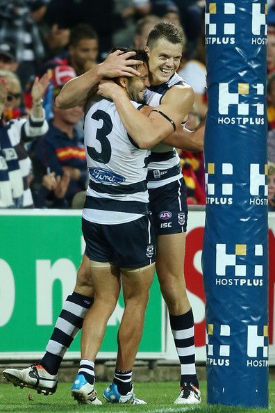 Hamish McIntosh and Jimmy Bartel celebrate a goal during the round one AFL match between the Geelong Cats and the Adelaide Crows at Skilled Stadium on March 20, 2014 in Melbourne, Australia. The levels of man love here are awesome.