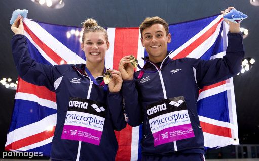 Great Britain's Tom Daley and Grace Reid celebrate with their gold medals after winning the 3m Synchro Diving Mixed Final during day three of the European Aquatics Championships at the London Aquatics Centre in Stratford. Photo by John Walton