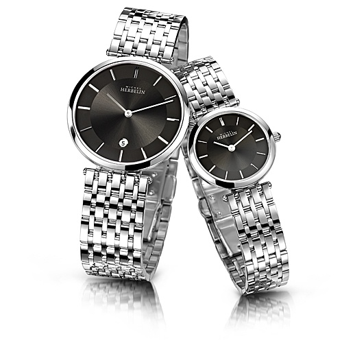 The simple, sleek dials on these extra slim women's and men's Michel Herbelin Epsilon watches make them monochrome statement pieces.