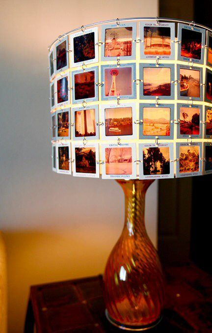 Make photos into slides and strip an old lampshade to the rim.  Attach slides using jump rings.  Very cool and retro!