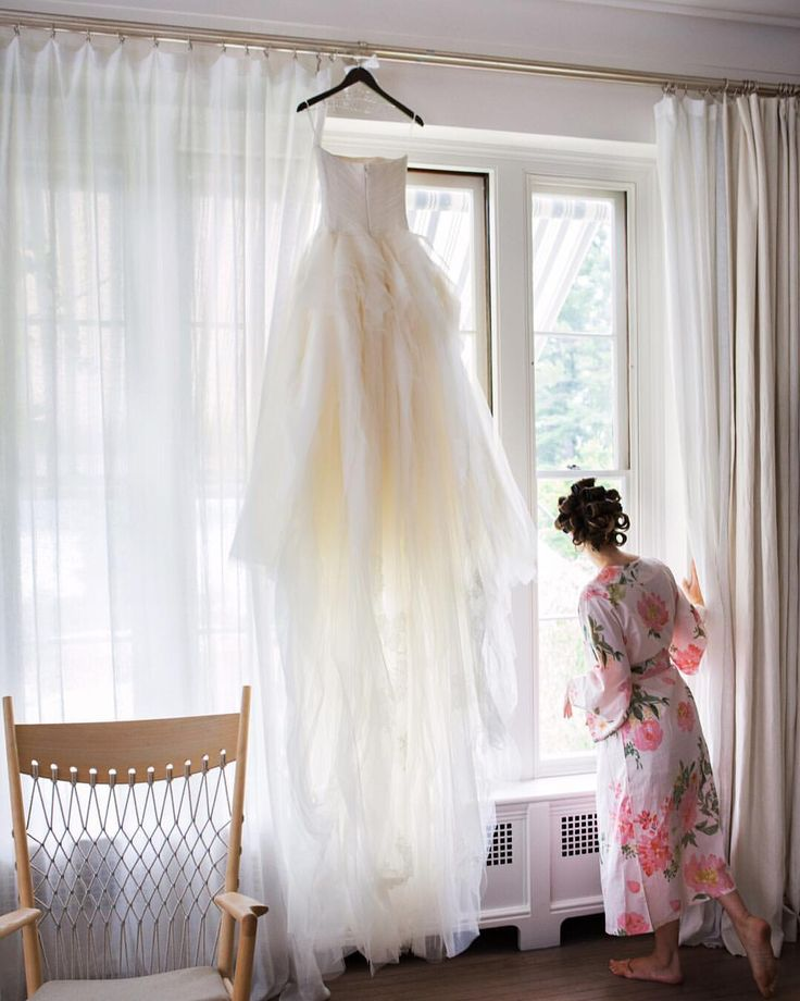 Stunning capture of the moments before the wedding. The bride to be wears Plum Pretty Sugar's Persimmon Ankle Robe and is photographed by Christian Oth. Shop: www.PlumPrettySugar.com