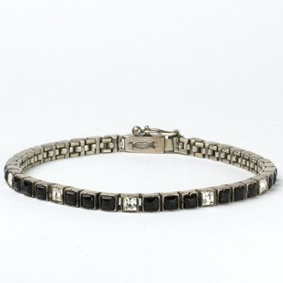 This 1920s sterling silver line bracelet in onyx-glass stones & diamanté by Fishel, Nessler is an Art Deco classic.