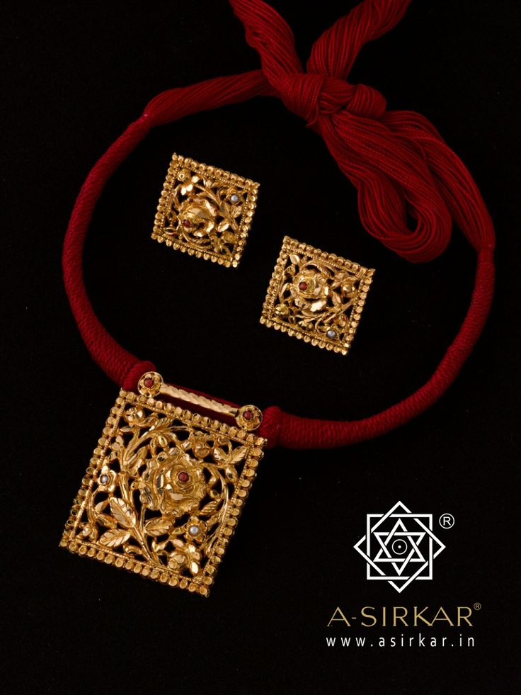 "Nasrin Be it the Mohammadi rose that yields the fragrant water with which the sacred Kaaba is washed, or the common Tea rose, or the wild roses of Persia...""a rose is a rose is a rose."" Hand-carved in pure 22K gold with a symbolic neck-ring of blood red thread that gives it a talismanic power, this humble set of pendant and earrings is our very own paean to a brave little schoolgirl who changed the world. Malala Yousafzai."