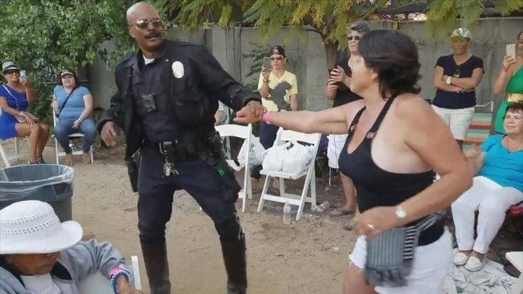 This officer is supposed to maintain law and order on the roads, but apparently anything goes on the dance floor. LAPD motorcycle officer Booker stopped by a Cuban American Music Festival and apparently couldn't help himself. Armed with a dance partner and some sick moves, he became the life of the party. People have been checking out his impressive salsa skills ever since the LAPD posted this video to Twitter. InsideEdition.com's Mara Montalbano (https://twitter.com/Ma...