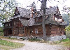 Zakopane Style architecture (or Witkiewicz Style architecture) is a mode inspired by the regional art of Poland's highland region known as Podhale. Drawing on the motifs and traditions in the buildings of the Carpathian Mountains, this synthesis was created by Stanisław Witkiewicz who was born in the Lithuanian village of Pašiaušė, and is now considered to be one of the core traditions of the Góral people.