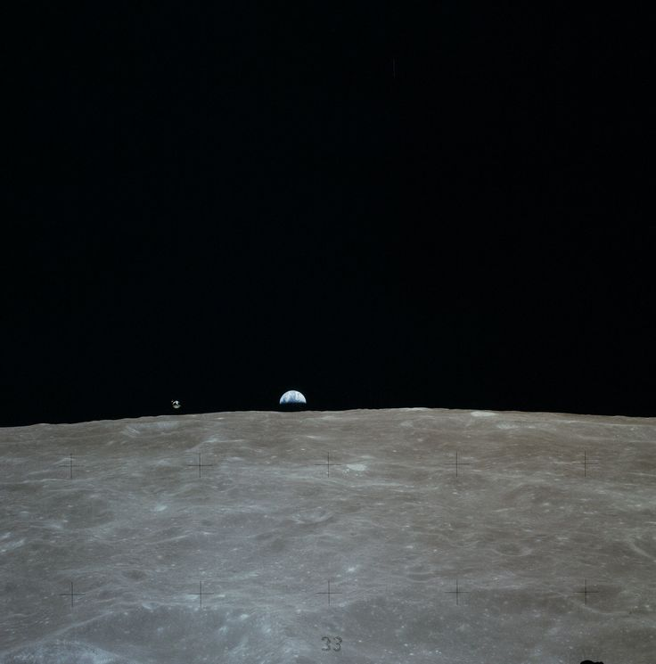 The Apollo 16 Command Module 'Casper' and the Earth as viewed from the Lunar Module Orion [2340 x 2369]