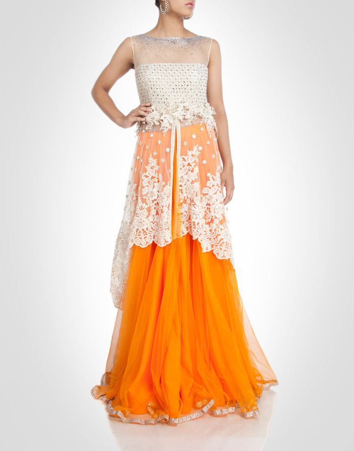 coral tone net lehenga with ivory tint floral work.  Shop Now: www.kimaya.in