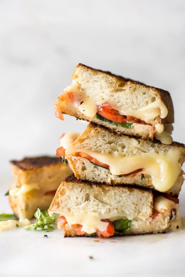 This gourmet Caprese grilled cheese sandwich is made with mayo instead of butter to get an ultra-crispy crust! This vegetarian recipe is quick, simple, and tasty comfort food. A healthier take on grilled cheese with tomatoes, basil, and fresh mozzarella. #grilledcheese