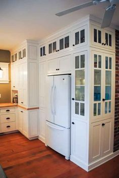 Love these cabinets and how they wrap around the refrigerator. #cabinets #kitchen #DSDecor