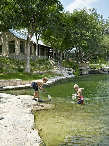 Willcott and Miller dammed a creek on their Texas property to widen the swimming hole enjoyed by their grandchildren, including Jesse (left) and Bentley.  Read more: Judy Wilcott and Laurence Miller Texas Ranch - Texas Ranch Decorating Ideas Follow us: @Elizabeth Lockhart Cassinos Living Magazine on Twitter | CountryLiving on Facebook Visit us at CountryLiving.com