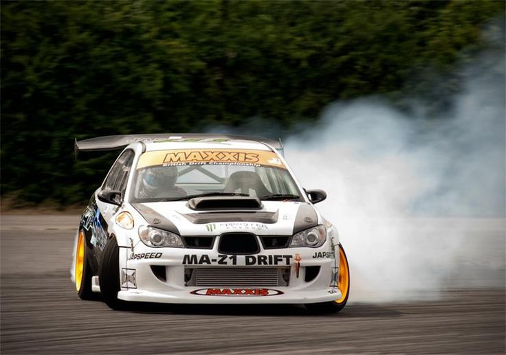 Drifting a 2006 Subaru wrx sti, don't really like the spoiler, still awesome