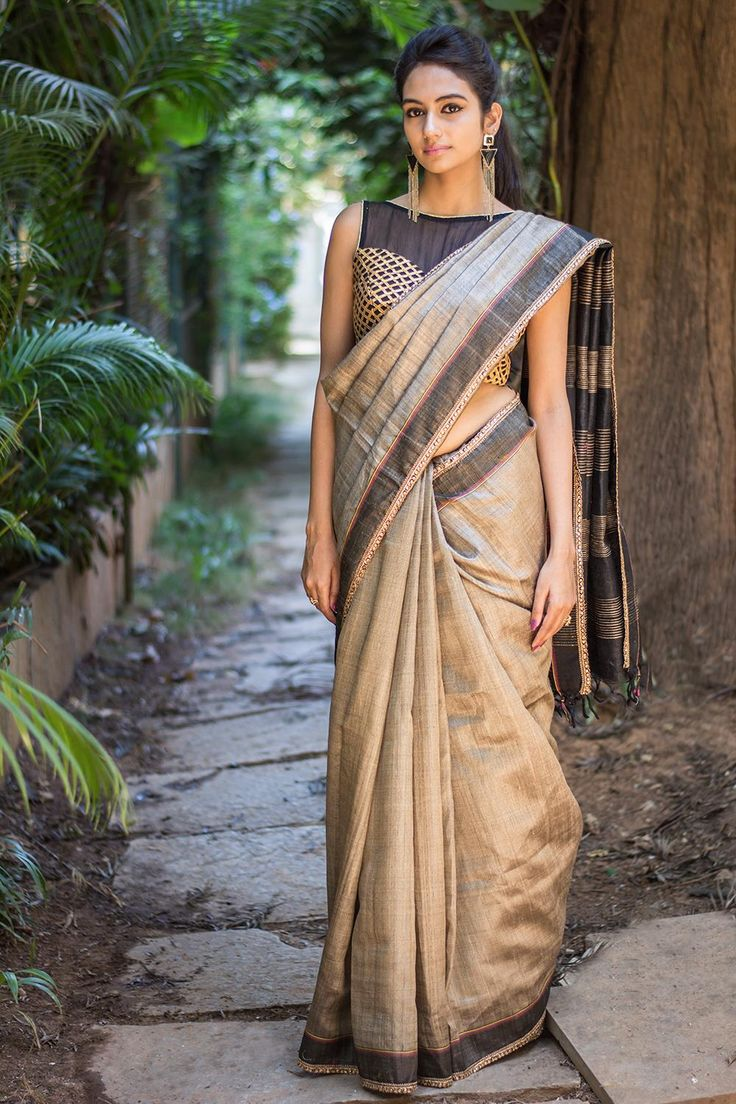 Another magical Tussar beauty! Understated in it's elegance with a subtle touch of antique stone edging, this earthy drape will soothe your soul...A sure fire black blouse pairing for this saree. Or sparkly away in a gold mixed blouse! #houseofblouse #saree  #blouse #indianwear #india #fashion #bollywood #beige #tussar
