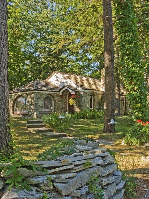 Mushroom Houses Of Charlevoix, Michigan Abide Cottage Is Nestled On A Small  Rise Under A Cluster Of Pine Trees.