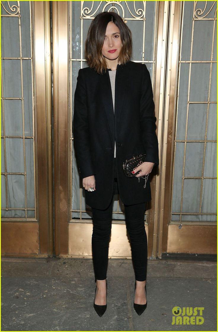 Rose Byrne in a Stella McCartney coat, Prada heels, 3×1 Denim jeans, and an Oroton clutch.
