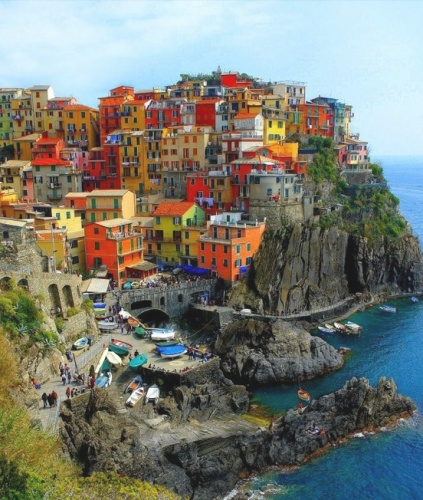 CINQUE TERRE, ITALY - you can only get there by boat, ferry or train... no cars allowed. And... that's fine by me, so long as I can just get there!