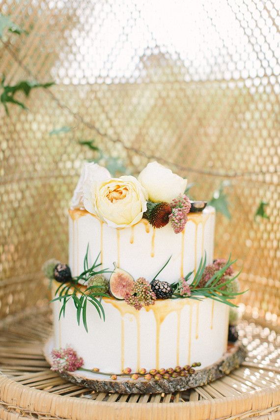Buttercup Bakery wedding cake, looks cool having the drips down the side. is it caramel? nice greenery for decoration instead of a ton of icing