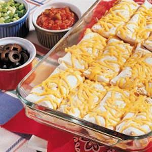 Bean Burritos Recipe -My husband and I have two sons, ages 5 and 3. With our demanding careers, main dishes like this one that can be prepared in a flash are essential for us. I always have the ingredients for this recipe on hand. Cooking the rice and shredding the cheese the night before save precious minutes at dinnertime. —Beth Osborne Skinner Bristol, Tennessee