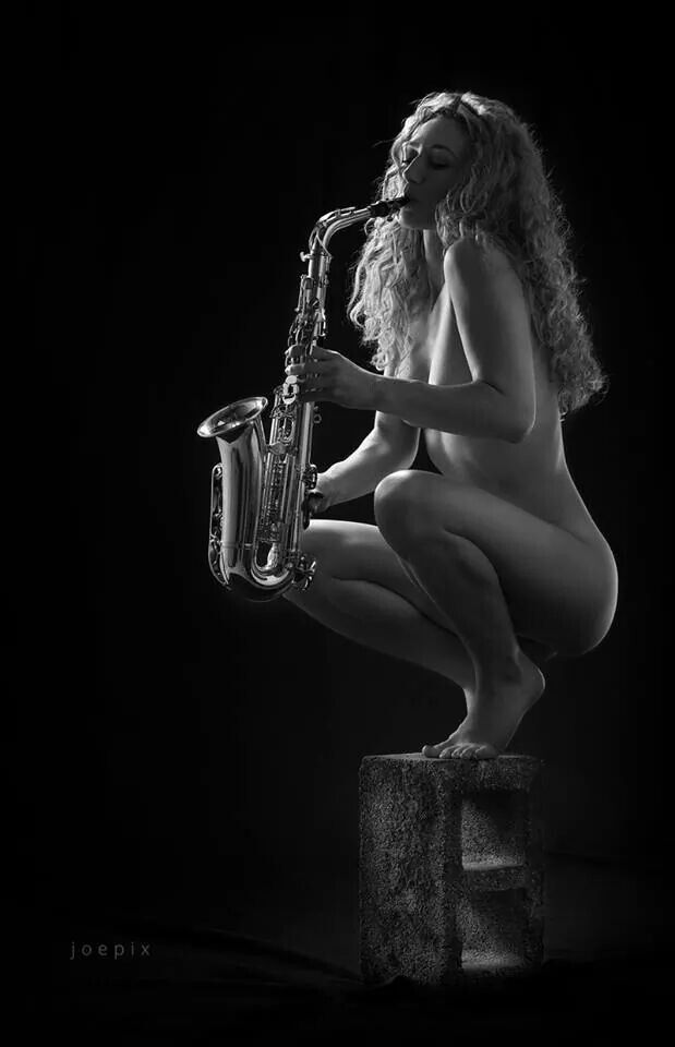 How Sexy girl saxophone player black aand white apologise
