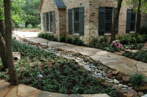 Swale next to a rock walkway landscaping pinterest for Home drainage issues