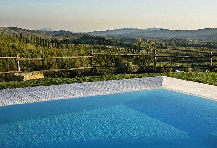 Солнечный тосканский стиль интерьера гостиницы Conti di San Bonifacio   тосканский стиль отель комфорт камин италья интерьер дизайн вино бассейн