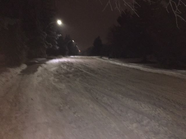 A mysterious winter road, bending, going nowhere but serenaded by lights dimmed by frosty air. [] Creativity sponsored by www.thebestrate.ca