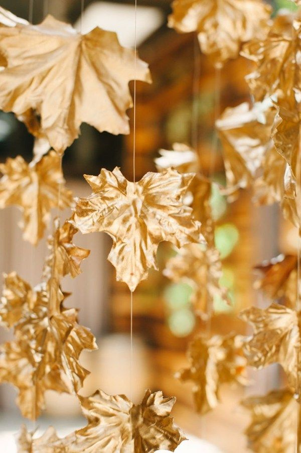 Paint fake gold leaves and thread string - backdrop