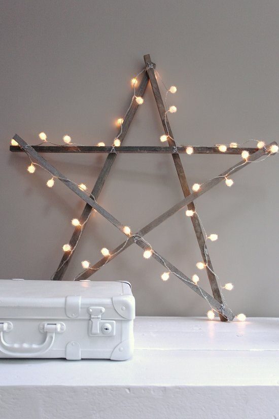 wooden star (painted dark brown, or burgundy) with lights for outside on the front porch.