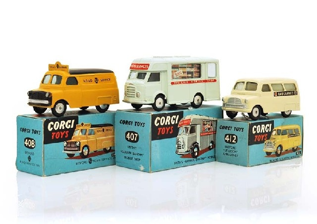 Lot No. 14  THREE CORGI COMMERCIAL VEHICLES INCLUDING 407, VERY PALE GREEN; 408; AND 412 (E-M BOXES VG) (3)  Estimate $300-$400