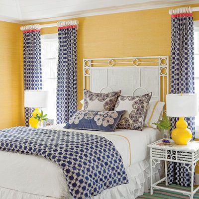 Pink, yellow, and navy makes for a fun spin on the primary color palette in this vividly inviting guest room. | Coastalliving.com