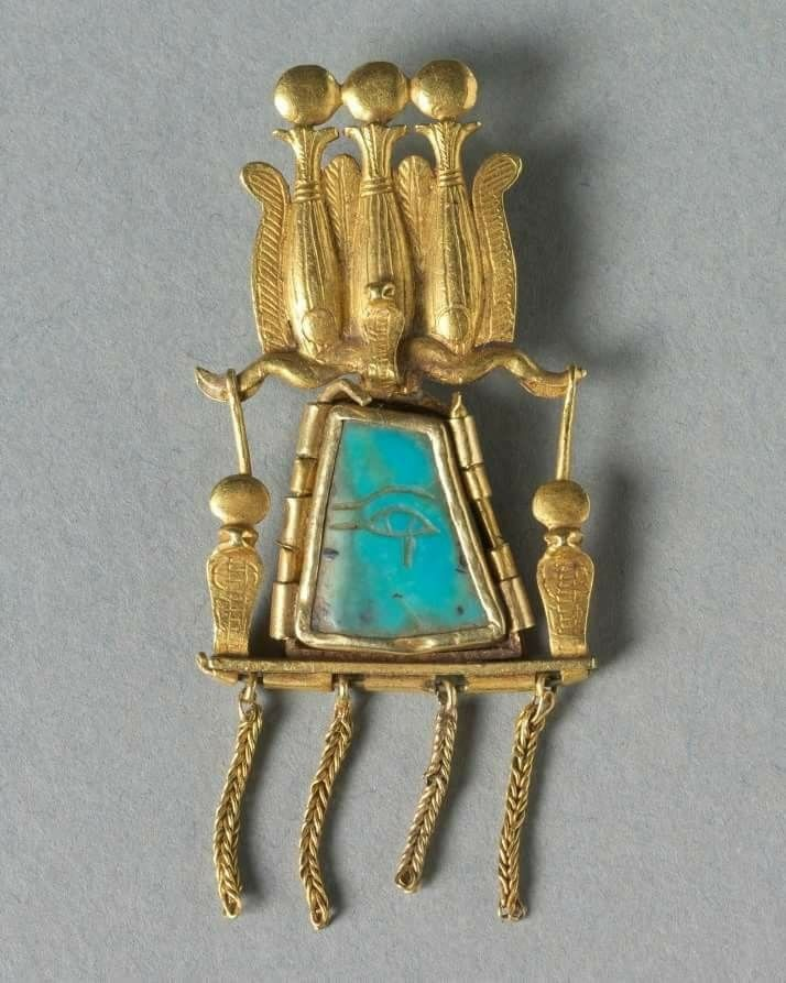 Ancient Egyptian Pendant, 1069-715 BC. Gold and turquoise, Overall: 5.1 x 2.3 cm (2 x 7/8 in). Gift of Vivian Merrin 1989.39, Currently at The Cleveland Museum of Art.   This pendant is similar in style and workmanship to the splendid jewelry found in the royal tombs of Dynasties 21 and 22 at Tanis, in the Nile Delta.