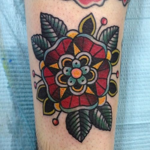 red flower and green leaves traditional tattoo - Traditional tattoos. love the detail!