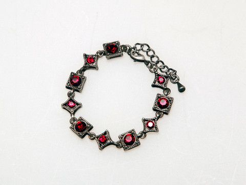 Ruby Red Bracelet: An eye-catching piece that creates a flair of mystique with its antique look. $30.00