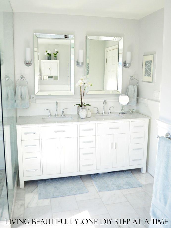 vanity, mirrors, towel hooks, marble tile floor