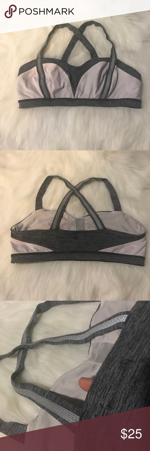 Lululemon Sports Bra Great condition sports bra. No padding (can get free from any lululemon store). Reflective bands down front and straps. See 4th photo for how light reflects. Heather like grey and off white color. It's hard to explain the lighter color. No trades please. Smoke free home. lululemon athletica Intimates & Sleepwear Bras