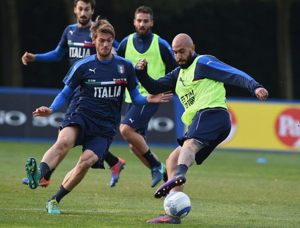 Daniele Rugani (L) and Simone Zaza of Italy in action during a training session at Milanello on November 13, 2016 in Cairate, Italy.