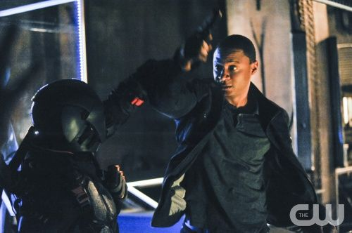 """Arrow has been building up a lot of big things, and this week's """"The Man Under the Hood"""" is no exception. Slade's war against Oliver has proceeded on many fronts, and Team Arrow is struggling to pl..."""