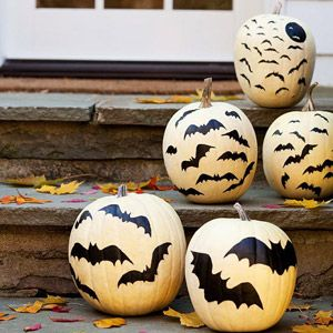 Paint pumpkins white and decorate with bat stencils