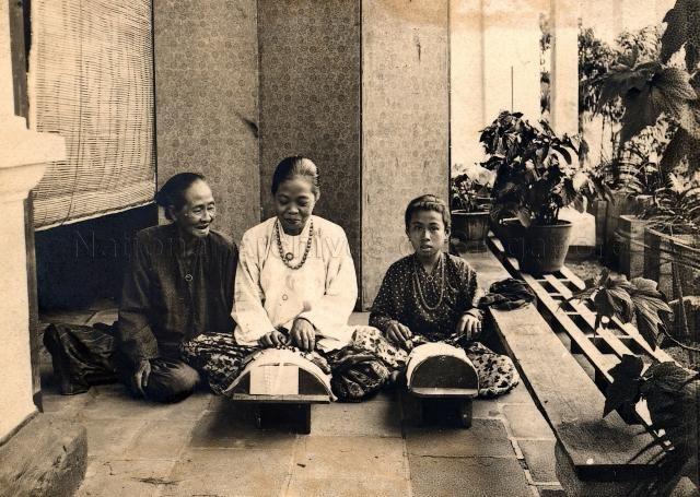 Womenfolk knitting lace in Malacca, Malaya - c.1910s