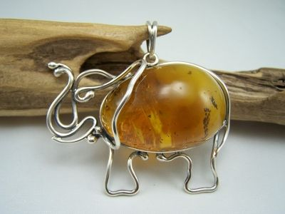 A unusual and unique large cognac amber, beautiful elephant silver pendant.