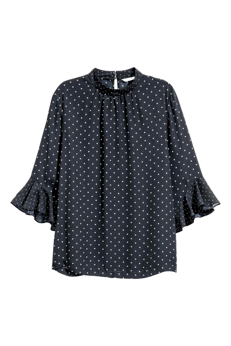 Blouse with flounced sleeves: CONSCIOUS. Blouse in an airy weave with a small stand-up collar, opening with covered buttons at the back of the neck and 3/4-length sleeves with a flounce at the cuffs. The blouse is made partly from recycled polyester.