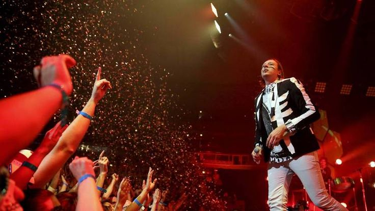 Arcade Fire throws United Center dance party