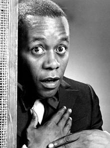 Flip Wilson in 1970 show. During the 1960s, Wilson became a regular at the Apollo Theater in Harlem and was a favorite guest on The Tonight Show, Laugh-In, and The Ed Sullivan Show. In 1970, Wilson won a Grammy Award for his comedy album The Devil Made Me Buy This Dress.