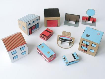 Robert Czajka's cardboard toy set inspired by modern Polish suburbia is one of the nicest eco-towns we know. Easy to make (punch-out and assemble), each kit contains four sheets of modern buildings, cars, a fence, a tree, a shop, a fountain and a garage, all made from sturdy, recycled cardboard. We love the bright graphics and think you'll be tempted to leave the set out on display. For little and big kids alike!4 pre-punched cardboard sheets: 30 x 38 cmBiggest element fol...