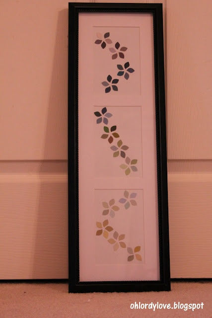 Art made with the little cut outs from Behr paint chips - how cool is that?!