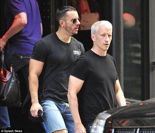 Anderson Cooper suits up for a stroll with boyfriend